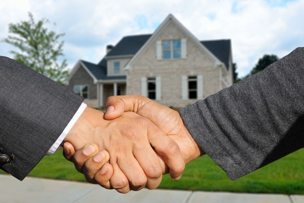 Title insurance agreement, two men shaking hands.
